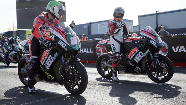 Derek McGee and Jeremy McWilliams give each other the thumbs up on the grid during the second 2018 Vauxhall International North West 200 on Thursday. PICTURE BY STEPHEN DAVISON