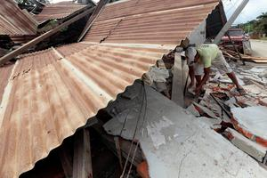A man removes rubble in Jama, in the Ecuadorean coastal province of Manabi, on April 18, 2016 two days after a 7.8-magnitude quake hit the country, on April 18, 2016. Rescuers and desperate families clawed through the rubble Monday to pull out survivors of an earthquake that killed 350 people and destroyed towns in a tourist area of Ecuador. / AFP PHOTO / Juan CevallosJUAN CEVALLOS/AFP/Getty Images