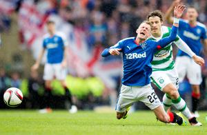 Celtic's Erik Sviatchenko tackles Rangers' Dean Shiels during the William Hill Scottish Cup semi-final match at Hampden Park, Glasgow. PRESS ASSOCIATION Photo. Picture date: Sunday April 17, 2016. See PA story SOCCER Rangers. Photo credit should read: Jeff Holmes/PA Wire. EDITORIAL USE ONLY