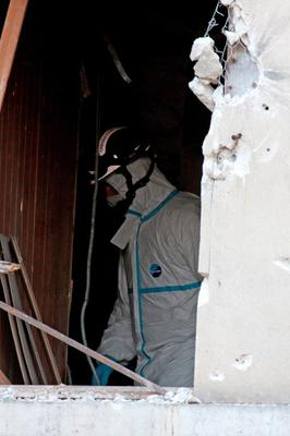 SAINT-DENIS, FRANCE - NOVEMBER 18:  A Police Forensic officer works in the damaged building that was raided earlier in the morning is pictured on November 18, 2015 in Saint-Denis, France. French Police special forces raided an apartment, hunting those behind the attacks that claimed 129 lives in the French capital five days ago. At least one person was killed in an apartment targeted during the operation aimed at the suspected mastermind of the attacks, Belgian Abdelhamid Abaaoud. At least five police officers have been wounded in the shootout.  (Photo by Pierre Suu/Getty Images)