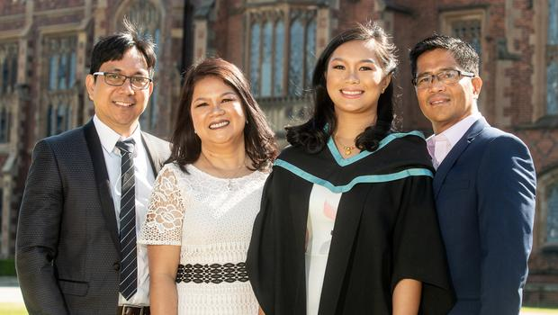 Images from the 10.30am graduation ceremony on Tuesday 3rd July Queen's University Belfast  Nariza Urbano graduates today with a BSc Degree in Adult Nursing from the School of Nursing and Midwifery at Queen's University.  Nariza is pictured with her family who joined her in celebration today.