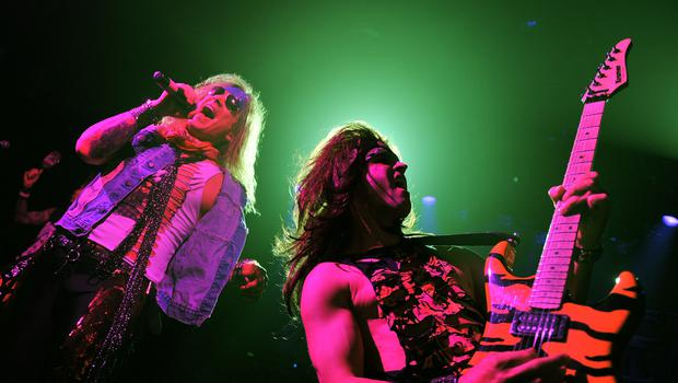 Singer Michael Starr and musician Satchel of Steel Panther perform at Irving Plaza on January 4, 2012 in New York City.  (Photo by Stephen Lovekin/Getty Images)