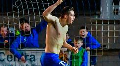 Crucial blow: Sean Noble celebrates his equaliser