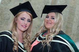 No Fee for Reproduction  Graduating from the Ulster University today with a degree in Community Youth Work  are, Megan Hamilton and Demi McClements. Picture Martin McKeown. Inpresspics.com. 20.06.15