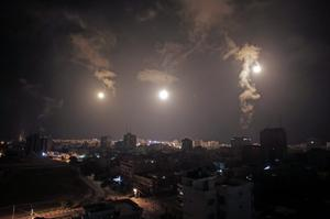 Israeli forces' flares light up the night sky of Gaza City on early Tuesday, July 29, 2014. (AP Photo/Khalil Hamra)
