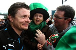 Brian O'Driscoll with supporters as the Ireland team arrive at Dublin Airport, Ireland. Pic Brian Lawless/PA Wire.