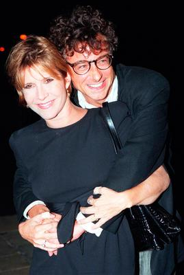 File photo dated 11/10/95 of Carrie Fisher with author Alan Jenkins as they arrive for the re-launch of the Star wars Trilogy at Alexandra Palace, as the actress has died at age 60, her daughter's publicist said. PRESS ASSOCIATION Photo. Picture date: Tuesday December 27, 2016. See PA story DEATH Fisher. Photo credit should read: Neil Munns/PA Wire