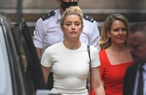 Actress Amber Heard leaves the High Court (Victoria Jones/PA)