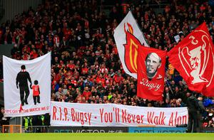 """Liverpool banners and flags in the stands before the Premier League match at Anfield, Liverpool. PRESS ASSOCIATION Photo. Picture date: Saturday April 1, 2017. See PA story SOCCER Liverpool. Photo credit should read: Peter Byrne/PA Wire. RESTRICTIONS: EDITORIAL USE ONLY No use with unauthorised audio, video, data, fixture lists, club/league logos or """"live"""" services. Online in-match use limited to 75 images, no video emulation. No use in betting, games or single club/league/player publications."""