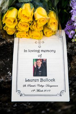 A mass booklet from a memorial service in memory of Lauren Bullock rests with floral tributes at the entrance of The Greenvale Hotel in Cookstown Co. Tyrone were three teenagers died on the evening of St Patrick's Day.  PRESS ASSOCIATION Photo. See PA story ULSTER Cookstown. Picture date: Tuesday March 19, 2019. Photo credit should read: Liam McBurney/PA Wire