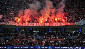 Flares are set off in the stands during the UEFA Champions League Final at Wembley Stadium, London. PRESS ASSOCIATION Photo. Picture date: Saturday May 25, 2013.