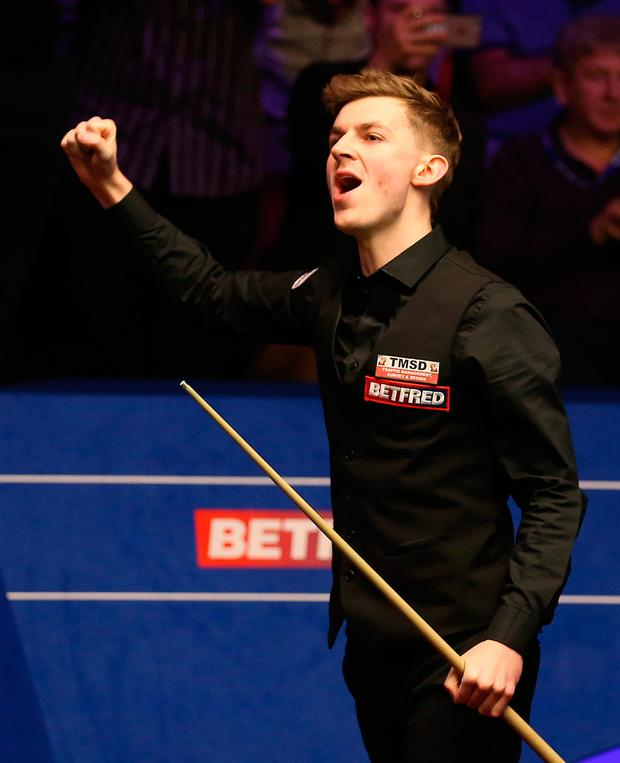 James Cahill celebrates after beating Ronnie O'Sullivan 10-8 during day four of the 2019 Betfred World Championship at The Crucible, Sheffield. PRESS ASSOCIATION Photo. Picture date: Tuesday April 23, 2019. See PA story SNOOKER World. Photo credit should read: Nigel French/PA Wire