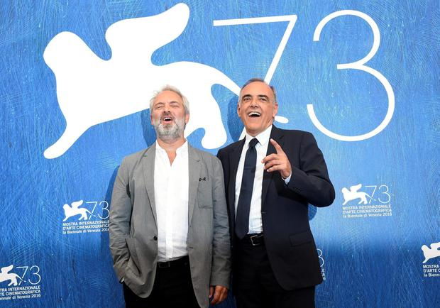 British director Sam Mendes, president of the jury 'Venezia 73', left, and Festival Director Alberto Barbera pose during the jury photo call at the 73rd Venice Film Festival in Venice, Italy, Aug. 31, 2016. The festival runs  from Aug. 31 through Sept. 10.  (Claudio Onorati/ANSA via AP)