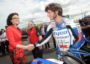 PACEMAKER, BELFAST, 15/5/2014: Secretary of State, Theresa Villiers meets Guy Martin (Tyco Suzuki) and Event Director, Mervyn Whyte MBE,  on the grid during the final qualifying session for the Vauxhall International North West 200 today. PICTURE BY STEPHEN DAVISON