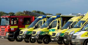 Emergency service vehicles line up on a former airfield close to The Mount Prison ( John Stillwell/PA)