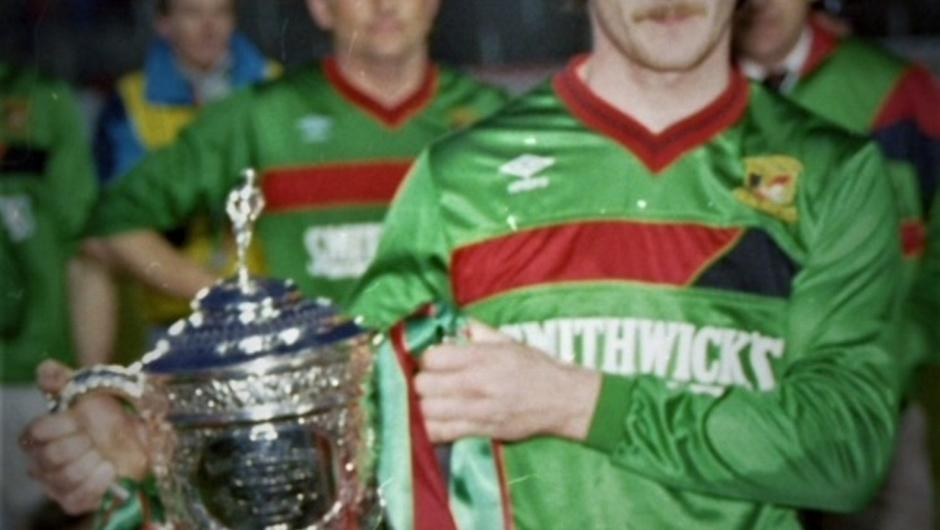 At last: Ron Manley, who scored 11 goals during the season, gets his hands on the Gibson Cup.