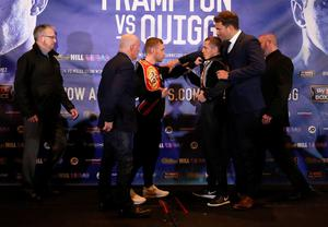 Carl Frampton (third left) and Scott Quigg (third right) are restrained by promoters Barry McGuigan and Eddie Hearn go head to head after a press conference at the Radisson Blu Hotel, Manchester.  Simon Cooper/PA Wire.