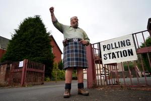Yes voter Duncan Thomson waits for the doors to open at St Martins Church hall polling station, as the people of Scotland take to the poles to decide whether Scotland should become an independent country, on September 18, 2014 in Renton, Scotland. After many months of campaigning, final opinion poles show the referendum result is still  too close to call. (Photo by Mark Runnacles/Getty Images)