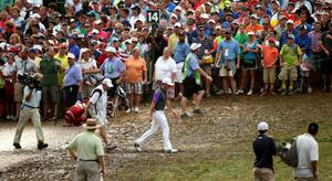 Rory McIlroy of Northern Ireland walks near the 14th hole as fans look on during the final round of the 96th PGA Championship at Valhalla Golf Club on August 10, 2014 in Louisville, Kentucky.  (Photo by Warren Little/Getty Images)