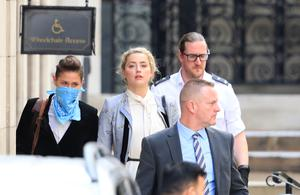 Actress Amber Heard leaves the High Court (Aaron Chown/PA)