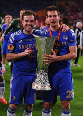AMSTERDAM, NETHERLANDS - MAY 15:  Juan Mata and Cesar Azpilicueta of Chelsea pose with the trophy during the UEFA Europa League Final between SL Benfica and Chelsea FC at Amsterdam Arena on May 15, 2013 in Amsterdam, Netherlands.  (Photo by Michael Regan/Getty Images)