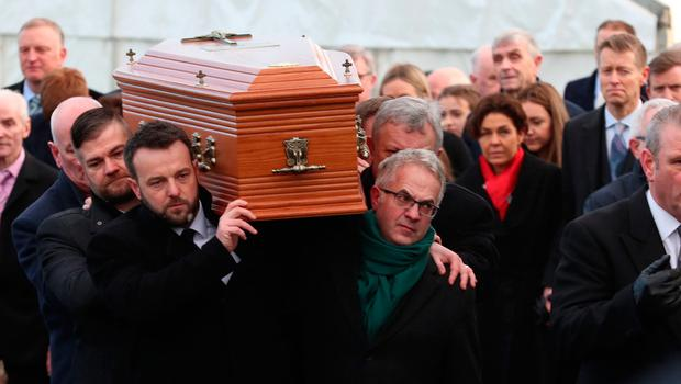 Colum Eastwood and Alex Attwood carry the coffin of Seamus Mallon. Pic: Liam McBurney/PA Wire