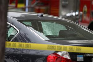 SANTA MONICA, CA - JUNE 07:  A bullet-riddled crashed car in which a woman was reportedly shot is seen near a burned home with two bodies inside after multiple shootings were reported at various locations including Santa Monica College June 7, 2013 in Santa Monica, California. According to reports, at least six people have died in the shootings.  (Photo by David McNew/Getty Images)