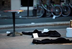 Coats lay on the floor in front of the Comptoir Voltaire cafe at the site of an attack on November 14, 2015 in Paris, after a series of gun attacks occurred across the city. AFP PHOTO /  KENZO TRIBOUILLARDKENZO TRIBOUILLARD/AFP/Getty Images