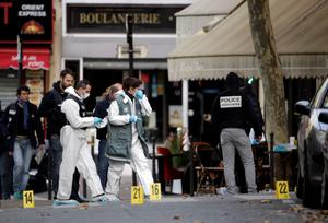 Forensic scientists inspect the Cafe Bonne Biere on Rue du Faubourg du Temple in Paris on November 14, 2015, following a series of coordinated attacks in and around Paris late Friday which left more than 120 people dead. According to witnesses, at least 5 people were killed in the immediate area by attackers wielding automatic rifles. AFP PHOTO /  KENZO TRIBOUILLARDKENZO TRIBOUILLARD/AFP/Getty Images