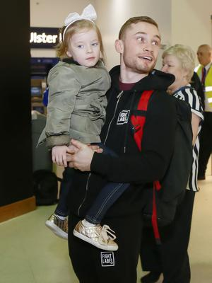 Carl Frampton arrived back home with his wife Christine, daughter Carla and son Rossa. Northern Ireland ( Photo by Kevin Scott / Presseye )