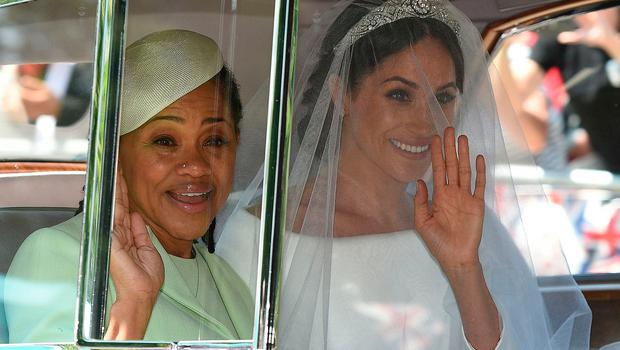 Meghan Markle (R) and her mother, Doria Ragland, arrive for her wedding ceremony to marry Britain's Prince Harry, Duke of Sussex, at St George's Chapel, Windsor Castle, in Windsor, on May 19, 2018. / AFP PHOTO / Oli SCARFFOLI SCARFF/AFP/Getty Images