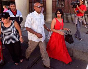 Celeste Nurse, right,  the mother of a girl that was kidnapped as a baby 17 years ago, leaves the court after attending the appearance of a woman suspected of the kidnapping in Cape Town, South Africa. (AP Photo)
