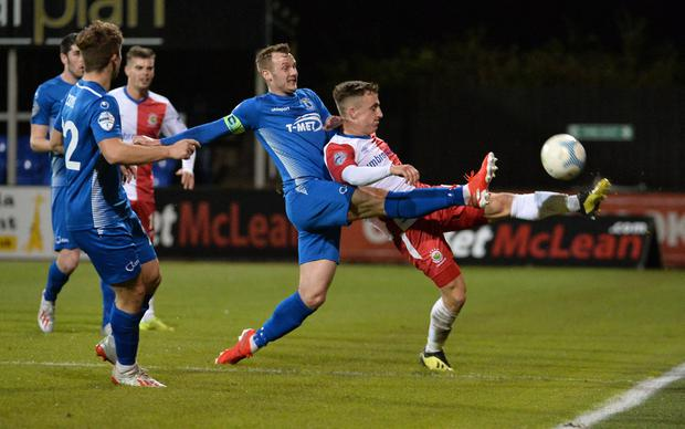 Linfield's Joel Cooper and Dungannon's Seanan Clucas during this evening's game at Stangmore Park. Credit: Colm Lenaghan/Pacemaker Press