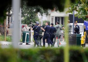 SANTA MONICA, CA - JUNE 07:  Los Angeles Police Department officers along with Los Angeles County Sheriff deputies search the grounds of Santa Monica College near the library after multiple shootings were reported on the campus June 7, 2013 in Santa Monica, California.  According to reports, at least three people have been injured, and a suspect was taken into custody. (Photo by Kevork Djansezian/Getty Images)