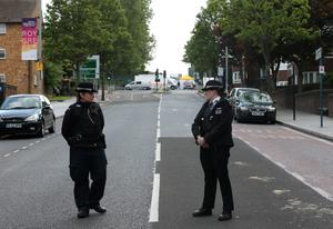 LONDON, ENGLAND - MAY 22:  Police near to the scene in Woolwich following a major incident in which a man was killed, on May 22, 2013 in London, England. It has been reported that the government and police are treating the attack in Woolwich on a serving soldier as a possible terrorist attack. Police have confirmed that one man has died after being attacked in the street by two men and firearms and knives were involved in the incident.  (Photo by Dan Kitwood/Getty Images)