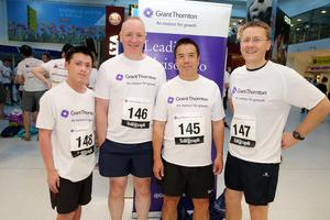 Press Eye - Belfast -  Northern Ireland - 24th June 2015 -  Leon Cheung, Paul Smith, Simon Cheung and Mark Tiernan from DTS at the first ever Grant Thornton Runway Run at Belfast City Airport this evening. Picture by Kelvin Boyes / Press Eye.