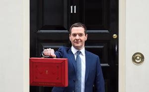 The Chancellor of the Exchequer George Osborne holds his ministerial red box up to the media as he leaves 11 Downing Street on July 8, 2015 in London, England. The Chancellor is presenting his summer budget today to Parliament and is expected to announce £12 billion in welfare cuts.  (Photo by Stuart C. Wilson/Getty Images)
