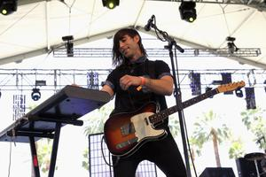 INDIO, CA - APRIL 12:  Musician Leopold Ross of Io Echo performs onstage during day 1 of the 2013 Coachella Valley Music & Arts Festival at the Empire Polo Club on April 12, 2013 in Indio, California.  (Photo by Karl Walter/Getty Images for Coachella)