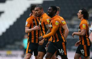 Hull City's Josh Magennis scored an early double at MK Dons.