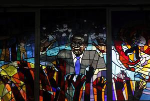 A stained glass panel inside the Regina Mundi Catholic Church in Soweto, South Africa   depicts former president Nelson Mandela durng a church service Sunday June 9, 2013. Worshippers were urged to pray for Mandela who has been hospitalized with a recurring lung infection. The latest government report says that Mandela remains in a serious but stable condition. (AP Photo/Denis Farrell)
