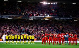 The team's stand for a minute's silence during the UEFA Europa League quarter final, second leg match between Liverpool and Borussia Dortmund at Anfield on April 14, 2016 in Liverpool, United Kingdom. (Photo by Clive Brunskill/Getty Images)