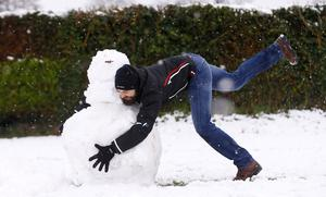 Lurgan Park covered in Snow as Sam rugby tackled his attempt at a snow man on January 30 2016 (Photo by Kevin Scott / Presseye)