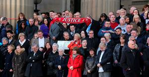 Family and friends of the victims on the steps join thousands of people  outside Liverpool's Saint George's Hall to attend a vigil for the 96 victims of the Hillsborough tragedy on April 27, 2016 in Liverpool, England. (Photo by Christopher Furlong/Getty Images)