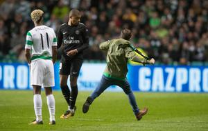 A Celtic fan ran on the pitch and confronted Kylian Mbappe of Paris Saint Germain during the UEFA Champions League match between Celtic and Paris Saint Germain