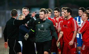 Raymond Crangle ordering the Newry City and Larne players to leave the pitch in a 2010 Irish Cup tie which was abandoned