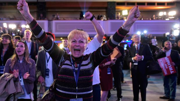 Supporters of Republican presidential nominee Donald Trump react as they watch sate by state results unfold on a TV screen during election night at the New York Hilton Midtown in New York on November 8, 2016.  / AFP PHOTO / Mandel NGANMANDEL NGAN/AFP/Getty Images