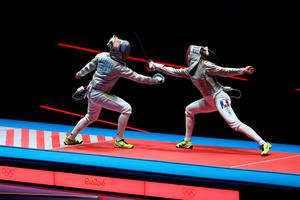 RIO DE JANEIRO, BRAZIL - AUGUST 08:  Manon Brunet of France (R) and Olga Kharlan of Ukraine compete during the Women's Individual Sabre Bronze Medal Bout on Day 3 of the Rio 2016 Olympic Games at Carioca Arena 3 on August 8, 2016 in Rio de Janeiro, Brazil.  (Photo by Dean Mouhtaropoulos/Getty Images)
