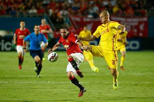 Juan Mata #8 of Manchester United battles with (R) Martin Skrtel #37 of Liverpool in the Guinness International Champions Cup 2014 Final at Sun Life Stadium on August 4, 2014 in Miami Gardens, Florida.  (Photo by Chris Trotman/Getty Images)