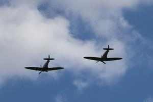 Two Spitfires pass overhead as the funeral cortege of Dame Vera Lynn pauses in Ditchling (Gareth Fuller/PA)