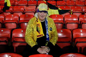 A fan in a sequinned jacket waits for kick off of the English Premier League football match between Watford and Chelsea at Vicarage Road Stadium in Watford, north of London on February 3, 2016. / AFP / ADRIAN DENNIS / RESTRICTED TO EDITORIAL USE. No use with unauthorized audio, video, data, fixture lists, club/league logos or 'live' services. Online in-match use limited to 75 images, no video emulation. No use in betting, games or single club/league/player publications.  / ADRIAN DENNIS/AFP/Getty Images